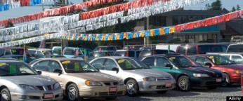 Used car lot with shiny banners overhead